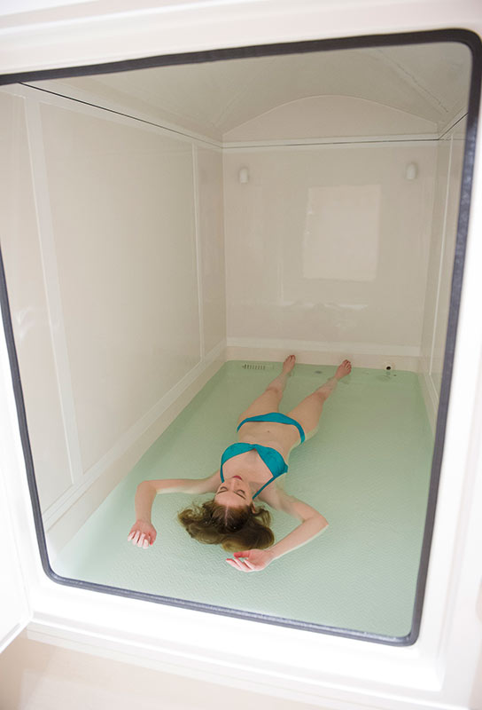 Woman floating in float tank